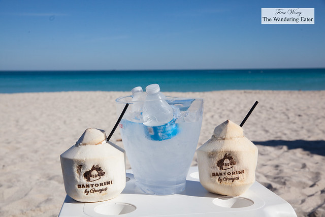 Coconut water (served in a coconut) and water on the beach