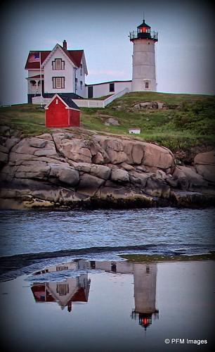 reflection reflections lighthouse nubblelight capeneddick maine light outdoor water sky rocks tower coast coastal ocean newengland canon eos 7d slr york faro phare mer oceano fence grass red blue green flickr