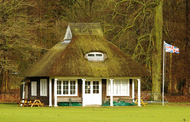 old english thatched roof building