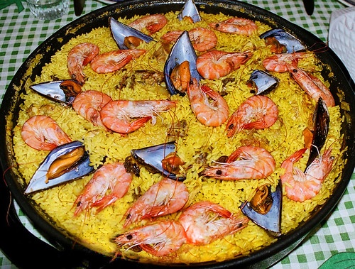 Paella with seafood and saffron rice in Spain