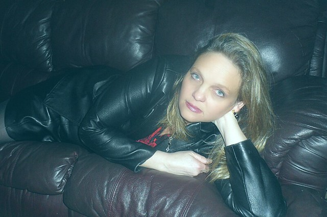 Blonde in Black Leather Skirt and Jacket