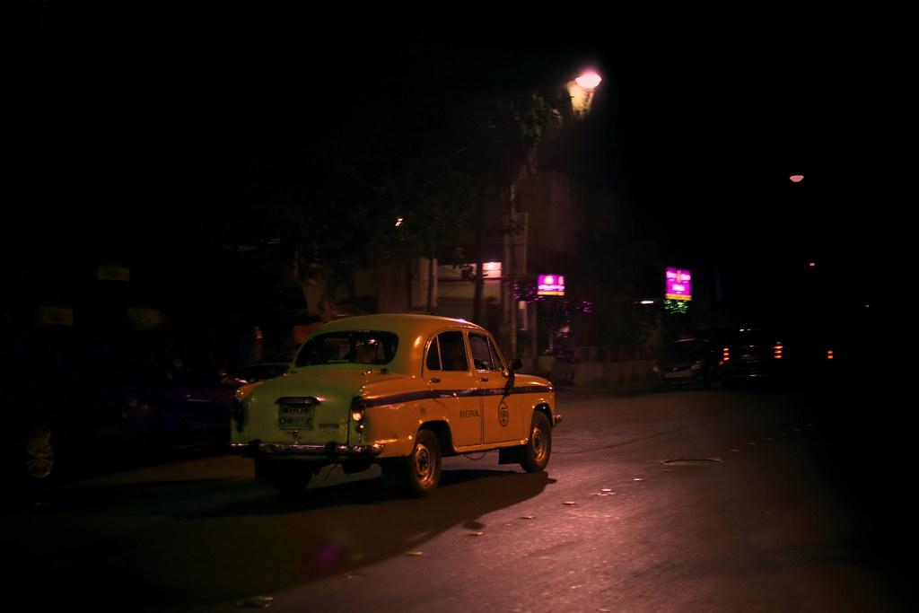 Image result for yellow taxi night kolkata
