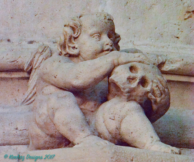 Burgos - Cathedral - Stone Carved Putti Cradling A Skull