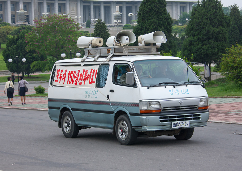Propaganda car with loudspeakers on the roof in the street, Pyongan Province, Pyongyang, North Korea