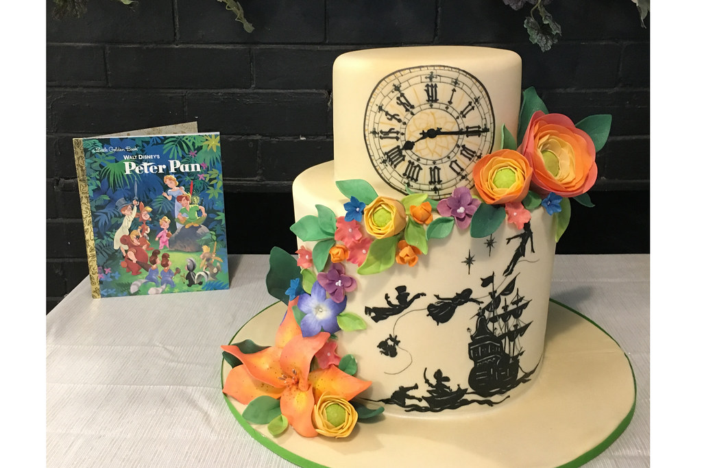 Outstanding Peter Pan Book With Flowers Birthday Cake Oakleaf Cakes Flickr Personalised Birthday Cards Beptaeletsinfo