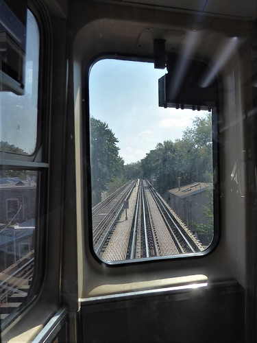 chicago ravenswood el l brownline lightrail transportation railcar metal stainlesssteel glass window tracks