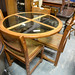 Circular oak and glass table and chairs E150