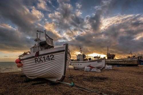 sigma1020f456 hastings beach nikon d7100 topazclarity sunset pebbles boat thestade eastsussex winter clouds england