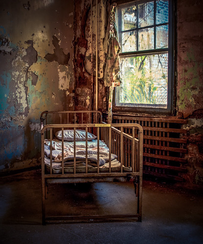pennsylvania state institution for feebleminded school hospital eastern epileptic pennhurst mayflower building bed abandoned america abandonedamerica neglected decayed window curtain light sunlight shadow decay awful