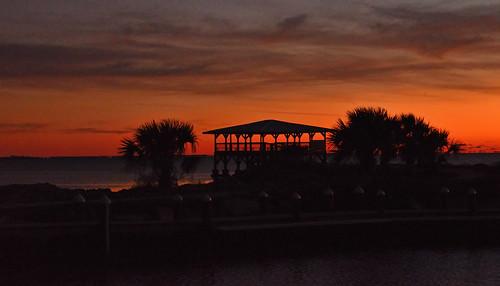 sunset structure orange red ocean water palmtrees portstjobay portstjo florida nature outdoors