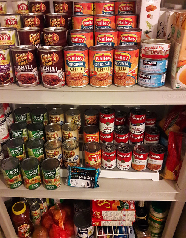 Pantry shelves,cans and boxes of food, beans, chill, soup, onion, tuna, crab, noodles, Olympia, Washington, USA