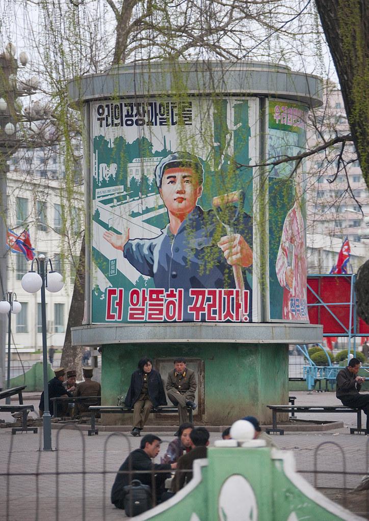 Propaganda billboard in a park depicting a worker, Pyongan Province, Pyongyang, North Korea