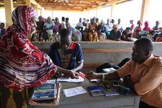 Recieving cash transfer payments | by World Bank Photo Collection