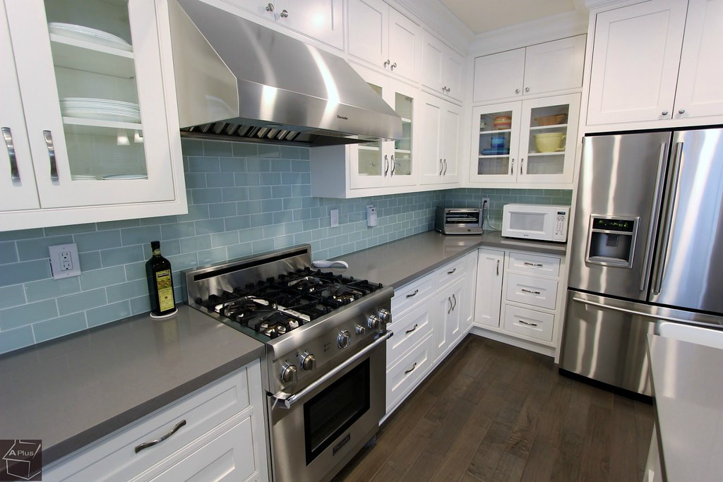 Kitchen Remodel with brand new white custom cabinets & hardwood floors in city of Irvine, Orange County http://www.aplushomeimprovements.com/portfolio_page/orange-county-irvine-kitchen-remodel-project65/