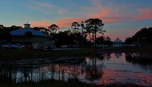 portstjo pond reflection lighthouse portstjolighthouse sunset outdoors florida clouds sky