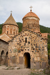 Dadivank Armenian monastery ancient church with khachkars and grinding stones