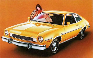 1975 Ford Pinto Two-Door Sedan Dealer Postcard, The Closer You Look . . . The Better We Look   by France1978