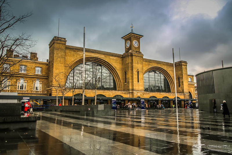 Exterior of Kingscross Station with the ground wet in front