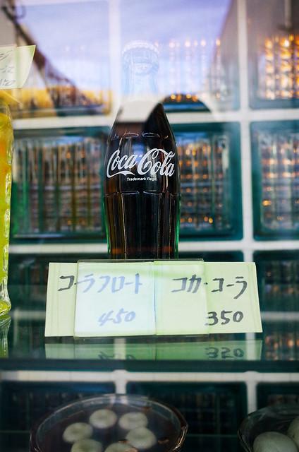Coca-Cola behind glass