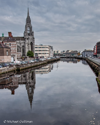 cork ireland riverlee holytrinitychurch capuchinfriary church cathedral gothic spire reflections river city cityscape water buildings cars automobiles sky clouds cloudyskies reflection nikon d90