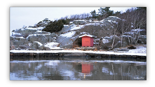 january winter cold sea water snow pier calm beach house shed rocks