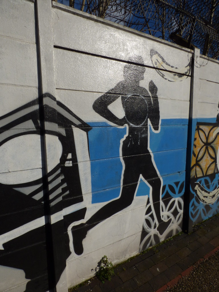 Grand union canal digbeth branch vandalised mural jogger and a banana