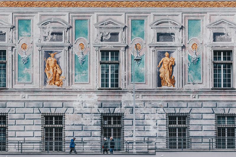 People walking by Palazzo San Giorgio