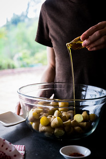 tossing the cooked potatoes with olive oil and spices | by Husbands That Cook