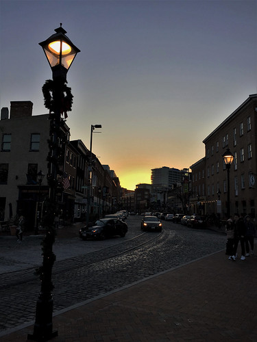 baltimore maryland fellspoint thamesst cobblestonestreet lampposts decorations lights sunset iphone topf25
