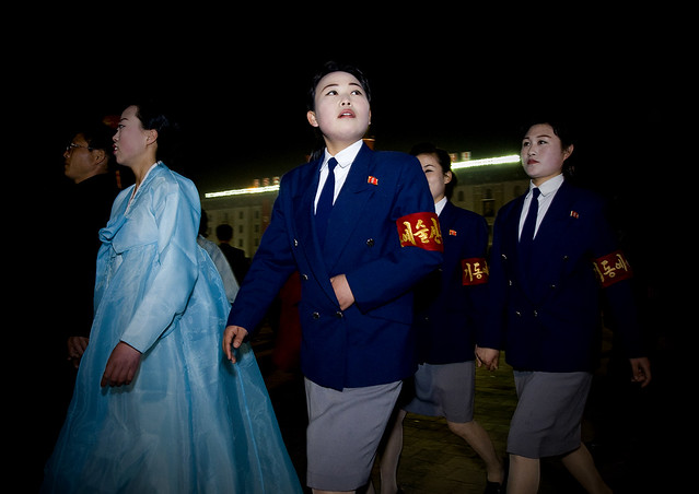 North Korean students dancing to celebrate april 15 the birth anniversary of Kim Il-sung on Kim il Sung square, Pyongan Province, Pyongyang, North Korea