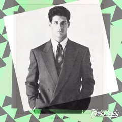 80s men?s suit clothing Advertisement with green and grey backround