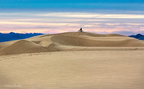 oceanodunes dunes sanddunes bike bikerider sand sandpatterns clouds getty gettyimages mimiditchie mimiditchiephotography