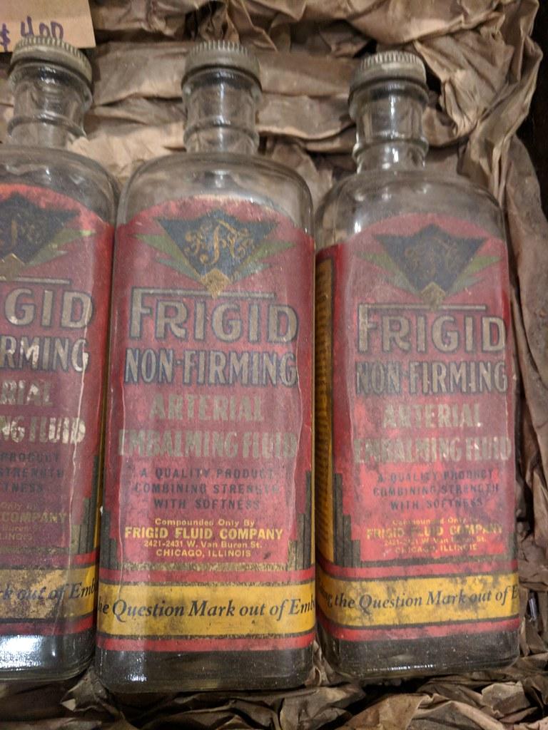 Frigid non-firming arterial embalming fluid bottles, Beard