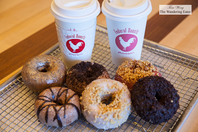 Our coffee and half dozen of fancy doughnuts -  Passion Fruit Poppy, Triple Chocolate, Churro, Crumberry, Cookies n Cream