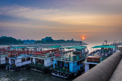boats clouds colors dawn landscape morning outdoor sea sky sun sunrise twilight water