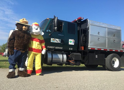 Photo of Smokey Bear and a friend with Maryland Forest Service fire truck