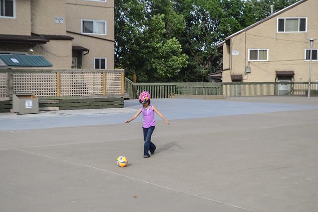 Kicking Around Her Ball