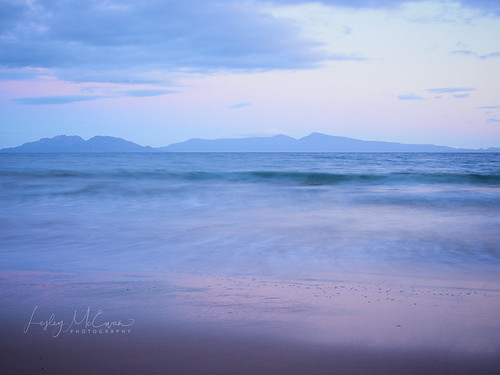 blue beach sea pink hills coast bay