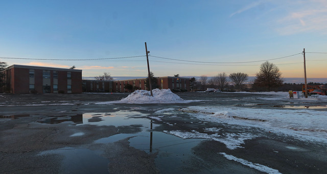 Lord Wakefield parking lot, snow bank and puddles; Wakefield, MA (2017)