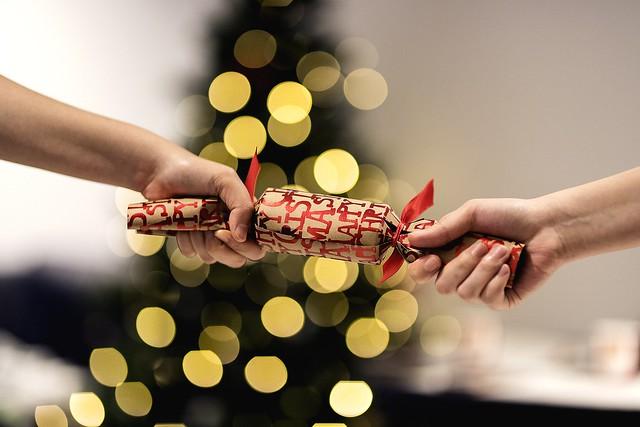 Pulling a christmas cracker