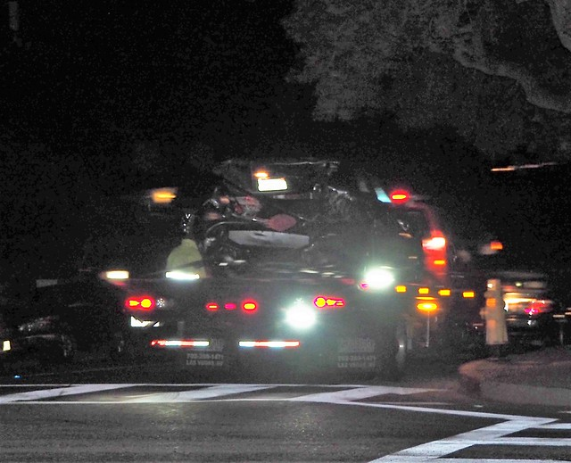 QC230155 Santa Barbara holiday lights tour State St Alamar smashed car on tow truck crop shad100 exp100