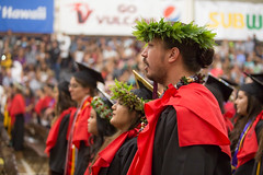 Students stand for their trip to the podium at the campus' commencement ceremony on December 16, 2017.  Photo by Everette Ganir