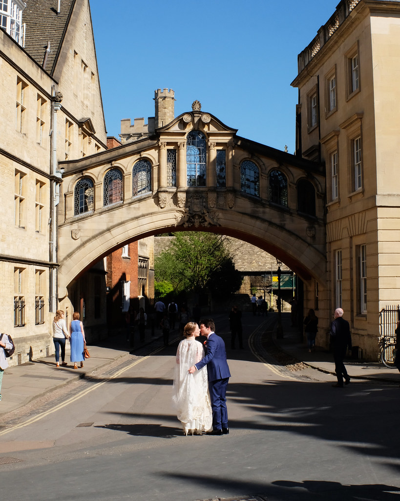 Newlyweds kiss on an Oxford street