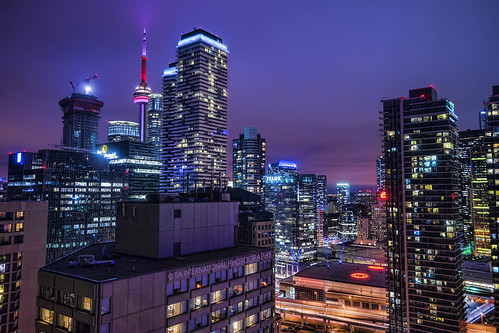 toronto ontario canada cityscape urban landscape metropolis night evening skyscraper building illumination lights city architecture design population view vista can cn tower landmark cloudy twilight downtown gardiner expressway highway harbourfront rooftop condo condominium residence financial district aircanada centre acc highrise telus ice york lavender pink purple violet sky tosinarasi tia ©tiainternationalphotography
