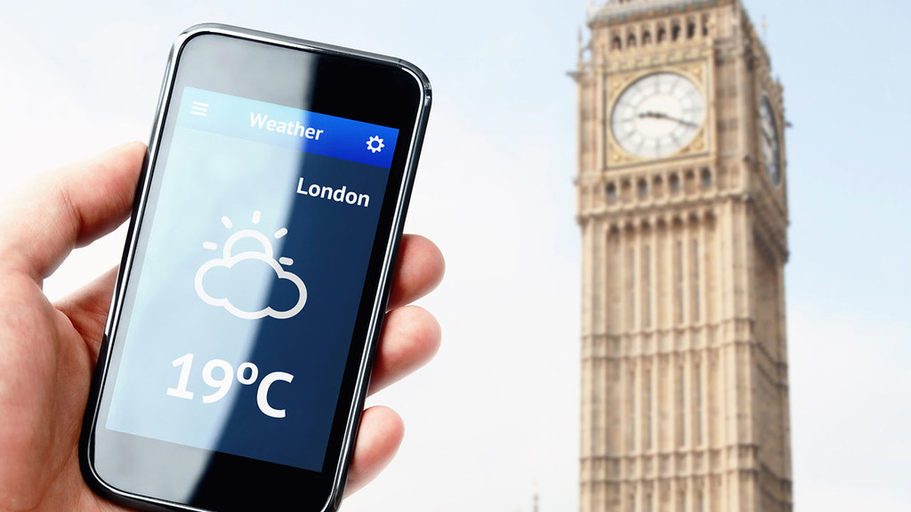 big ben and smartphone with weather forecast