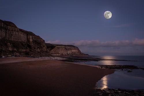 hastings beach nikon d7100 sea cliffs rocks reflections pebbles moon sigma1750f28exdcoshsm eastsussex winter clouds