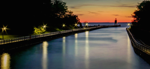 charlevoix michigan channel river water reflections color lights long exposure lighthouse pier railings sunlit sundown sunset evening red canon orange landscape sea seascape horizon