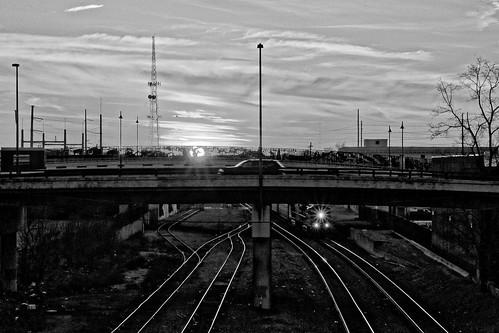 d90 sigma1770os train sunset overpass starburst f22 tracks tulsa downtown sun blackandwhite ononesoftware on1photoraw2018 topazdenoise dxofilmpack5