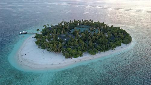 maldives ocean island atoll hotel resort beach people sea mavic aerial water