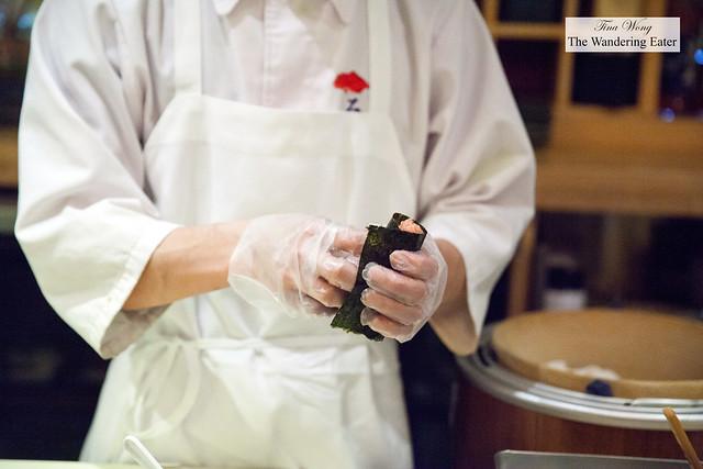 Chef making spicy chutoro  hand roll